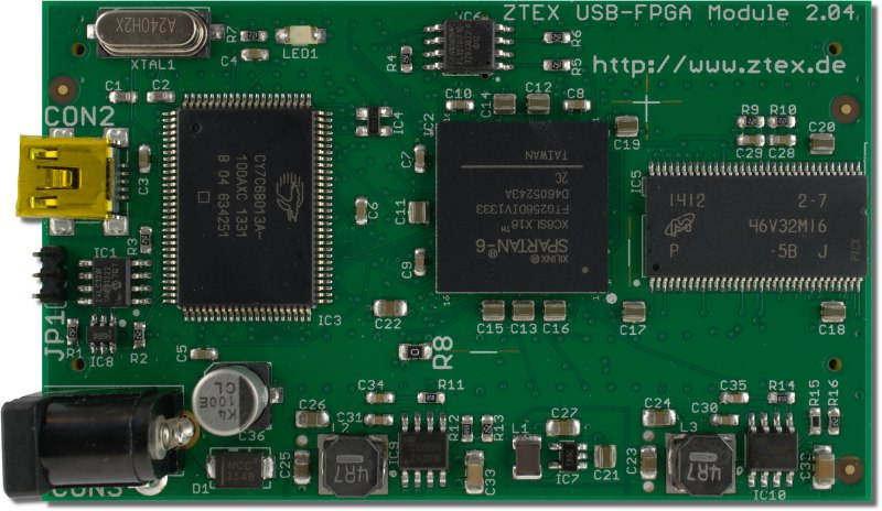 Top side of the ZTEX FPGA Board with Spartan 6 XC6SLX16 FPGA, DDR SDRAM and USB 2.0