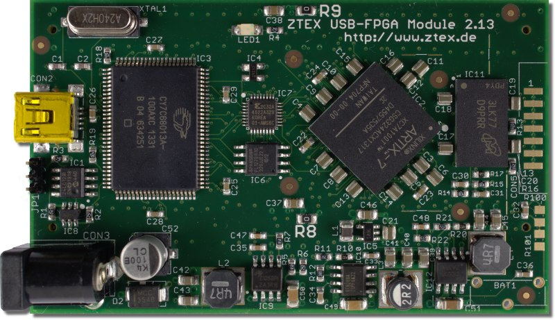 Top side of the ZTEX USB-FPGA Module 2.13d with Artix 7 XC7A100T FPGA, 256 MB DDR3 SDRAM and USB 2.0