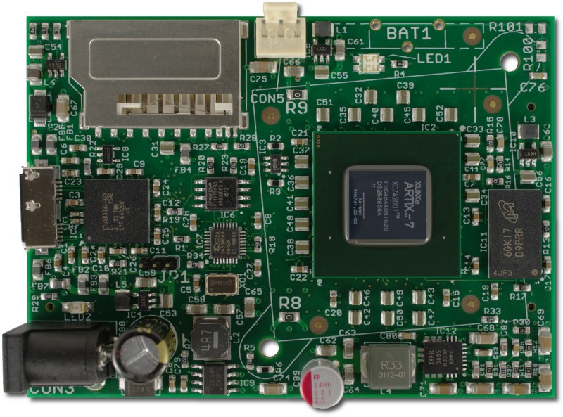 Top side of the ZTEX USB-FPGA Module 2.18 with Artix 7 XC7A200T, DDR3 SDRAM and FX3 USB 3.0 controller